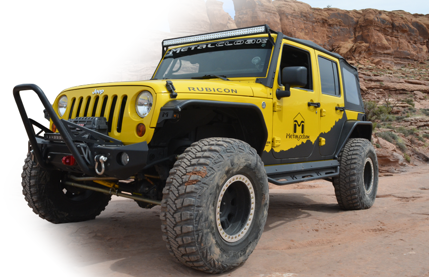 Yellow Jeep JL Wrangler with MetalCloak gear in the desert